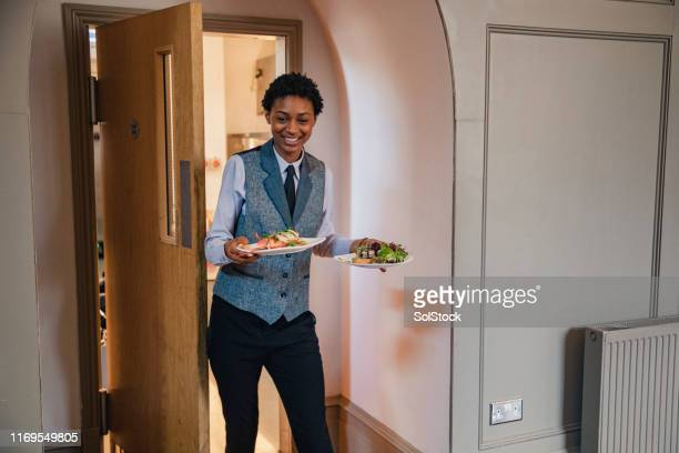 she loves her job - waiter stock pictures, royalty-free photos & images