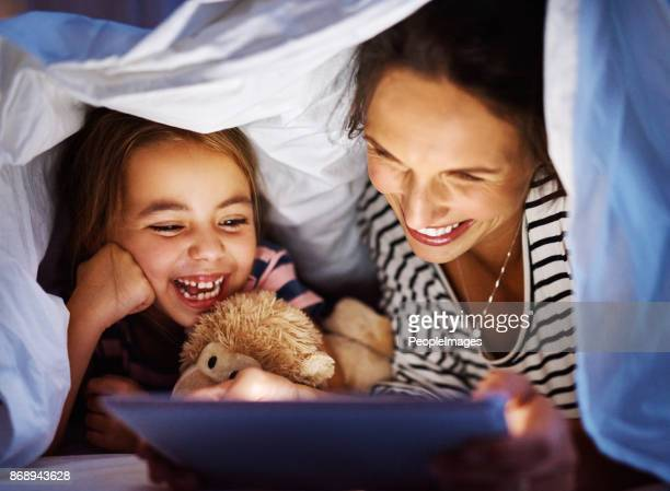 she loves her stories - super mom stock photos and pictures