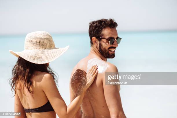 she loves his skin - sunbathing stock pictures, royalty-free photos & images