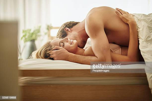 she loves it when he nuzzles her neck - erotische stockfoto's en -beelden