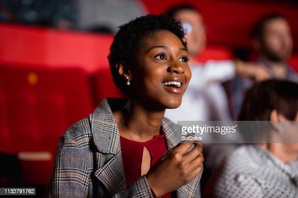 she loves the movies! - film industry stock pictures, royalty-free photos & images