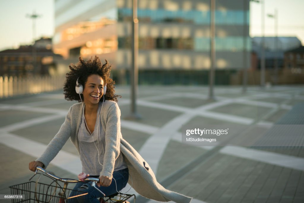 She loves to ride a bicycle : Stock Photo