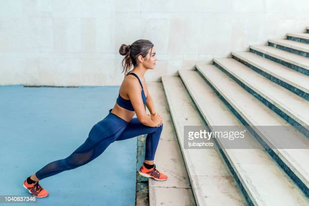 she makes fitness a way of life - stretching stock pictures, royalty-free photos & images