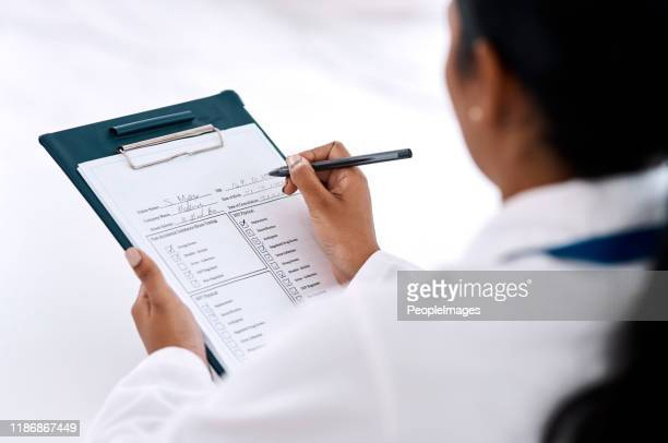 she makes sure she gets all paperwork under control - checklist stock pictures, royalty-free photos & images