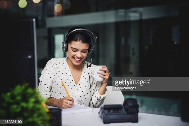 she makes the night shift look easy - hands free device stock pictures, royalty-free photos & images