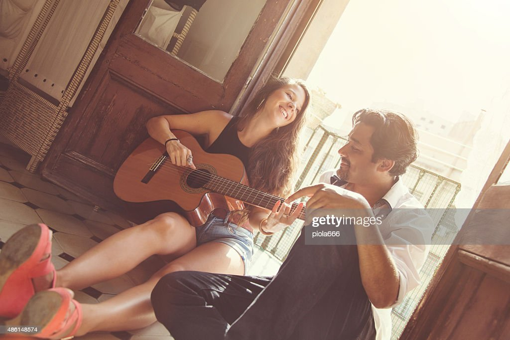 She plays for him : Stock Photo