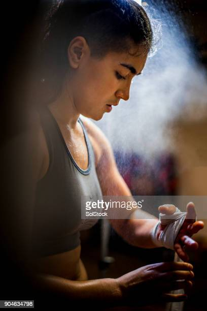 she prepares herself for boxing - tomboy stock photos and pictures