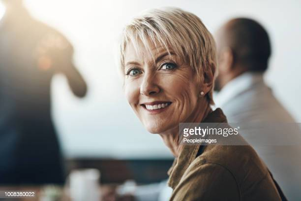 she really stands out in her team - one mature woman only stock pictures, royalty-free photos & images