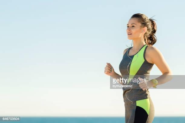 She running near sea