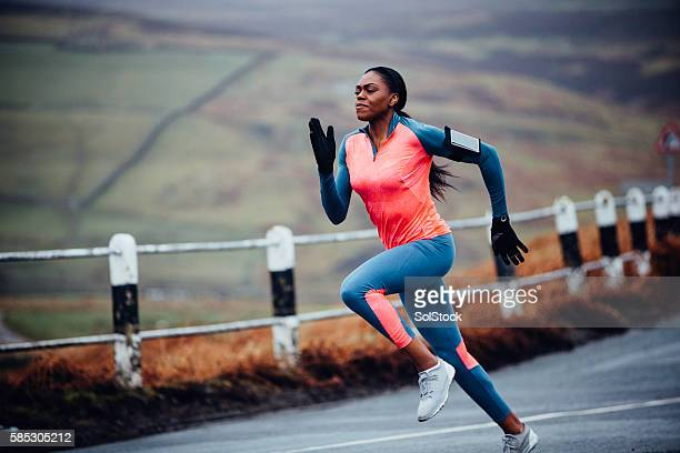 she runs like the wind! - black glove stock pictures, royalty-free photos & images