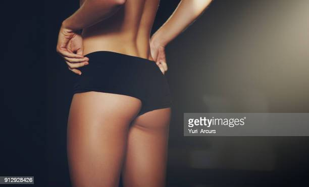 she stays in shape - woman bum stock photos and pictures