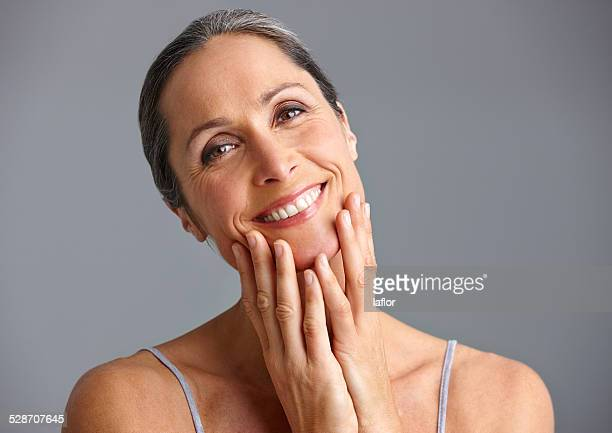 she takes good care of her skin - pretty older women stock pictures, royalty-free photos & images