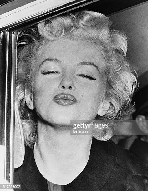 She was pretty well tuckered out after a flight from the West Coast but Marilyn Monroe puckered up like this on her arrival at Idlewild Airport She...