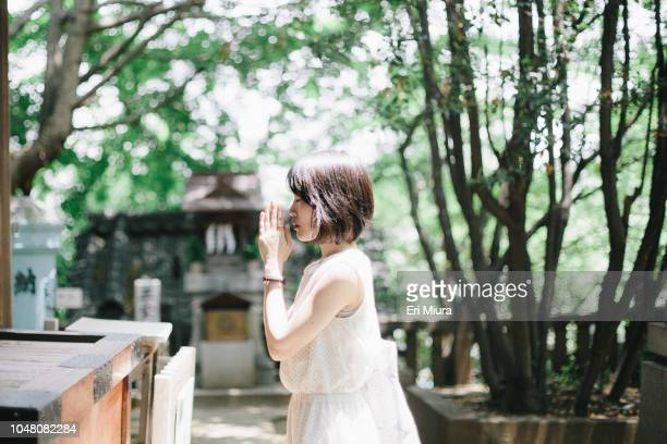 she wishes in a shrine. - shrine stock pictures, royalty-free photos & images