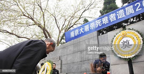 She Ziqinga survivor from Nanjing Massacre bows to his relatives died in on that time at Memorial Hall of the Victims in Nanjing Massacre by Japanese...