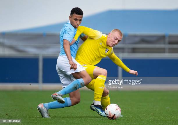 Shea Charles of Manchester City and Mika Biereth of Fulham in action during the U18 Premier League match between Manchester City and Fulham at The...