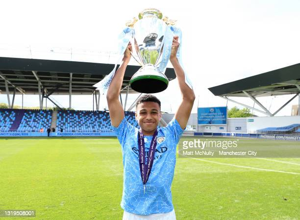 Shea Charles of Manchester City celebrates with the Premier League trophy during the U18 Premier League Final match between Manchester City and...