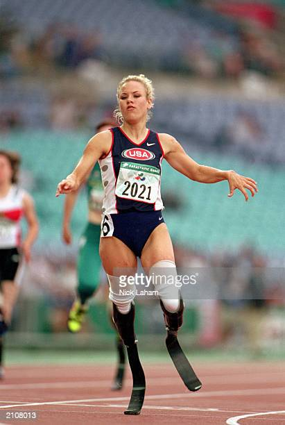 Shea Cowart of the USA sprints to set a World Record in the Womens 100m T44 Final during the Sydney 2000 Paralympic Games on October 26, 2000 at...