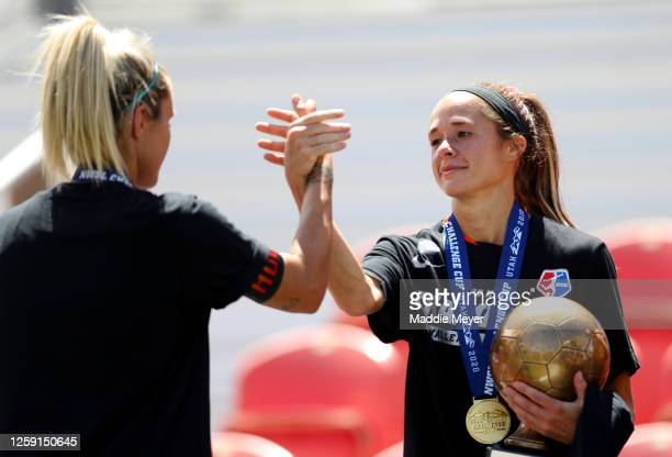 Shea Groom of Houston Dash is congratulated by teammate Rachel Daly after recieving the MVP Trophy after defeating the Chicago Red Stars to win the...