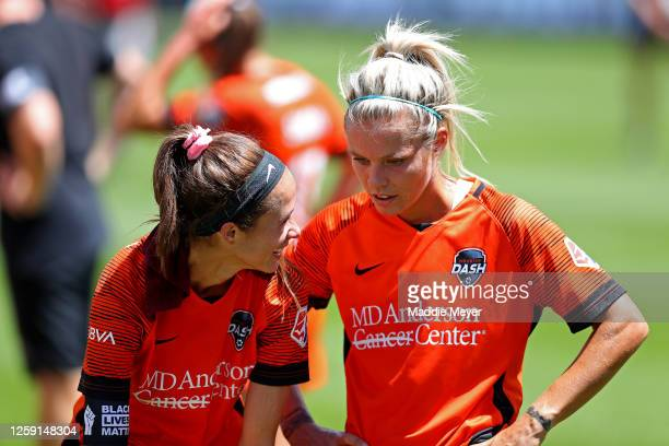 Shea Groom and Rachel Daly of Houston Dash celebrate after defeating the Chicago Red Stars to win the championship game of the NWSL Challenge Cup at...