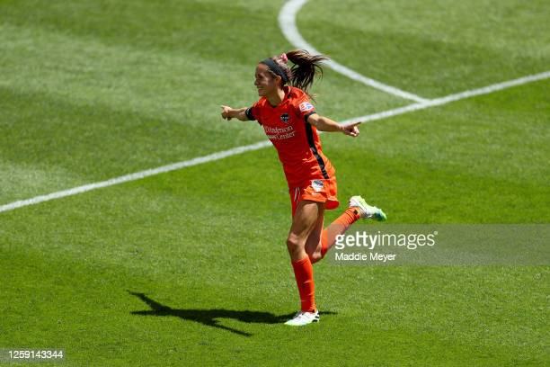 Shea Groom of Houston Dash celebrates after scoring a goal in the 91st minute against Alyssa Naeher of Chicago Red Stars during the second half in...