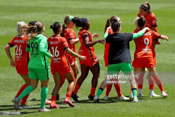 Shea Groom of Houston Dash celebrates with her teammates after defeating the Chicago Red Stars to win the championship game of the NWSL Challenge Cup...