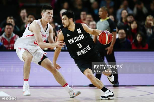 Shea Ili of New Zealand competes against Abudushalamu Abudurexiti of China during the FIBA World Cup Qualifying match between the New Zealand Tall...