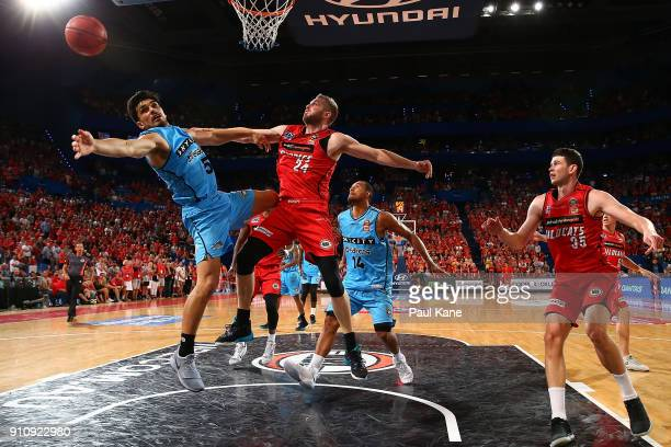 Shea Ili of the Breakers and Jesse Wagstaff of the Wildcats contest a rebound during the round 16 NBL match between the Perth Wildcats and the New...