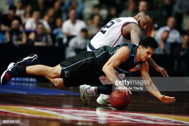 Shea Ili of the Breakers dives for a loose ball against Shannon Shorter of the 36ers during the round five NBL match between the New Zealand Breakers...
