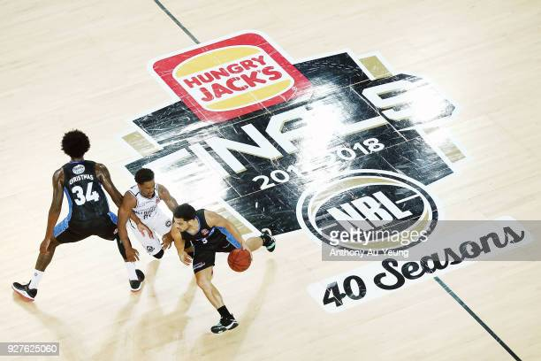 Shea Ili of the Breakers drives against Casper Ware of United during game two of the NBL semi final series between Melbourne United and the New...