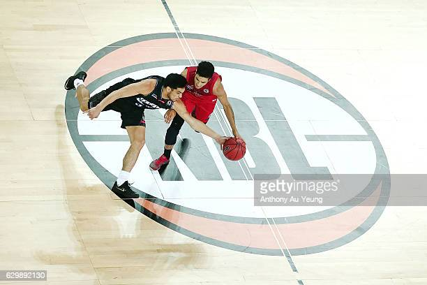 Shea Ili of the Breakers goes for the steal against Mason Bragg of the Wildcats during the round 11 NBL match between New Zealand Breakers and Perth...