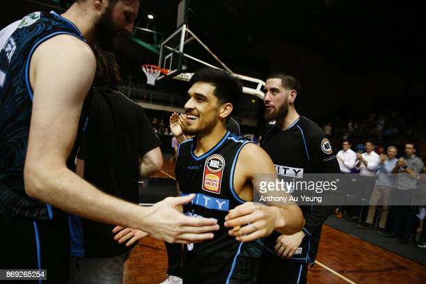 Shea Ili of the Breakers is congratulated by teammates after winning the round five NBL match between the New Zealand Breakers and the Adelaide 36ers...