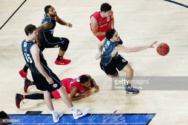 Shea Ili of the Breakers takes the loose ball from Bryce Cotton of the Wildcats during the round six NBL match between the New Zealand Breakers and...