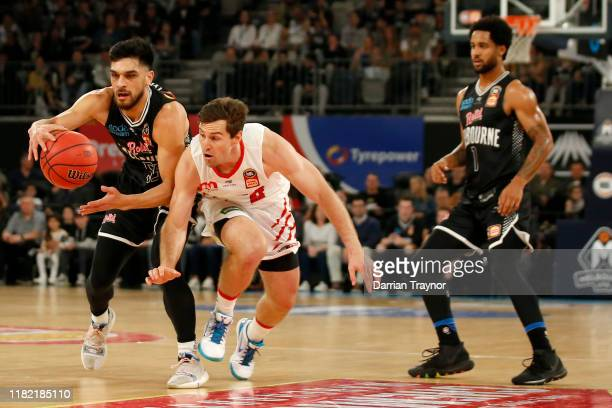 Shea Ili of United and Mitchell Norton of the Wildcats compete for the ball during the round three NBL match between Melbourne United and the Perth...