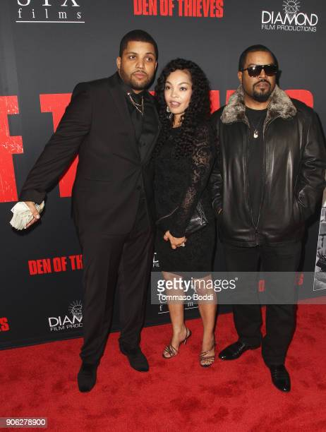 Shea Jackson Jr Kimberly Woodruff and Ice Cube attend the Premiere Of STX Films' Den Of Thieves at Regal LA Live Stadium 14 on January 17 2018 in Los...