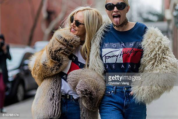 Shea Marie and Caroline Vreeland wearing a beige fur jacket and a blue Tommy Hilfiger shirt and blue denim jeans seen outside Tommy Hilfiger during...