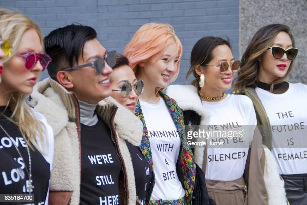 Shea Marie Irene Kim Aimee Song and Chriselle Lim are seen at Spring Studios outside the Phillip Lim show wearing black and white matching protest...