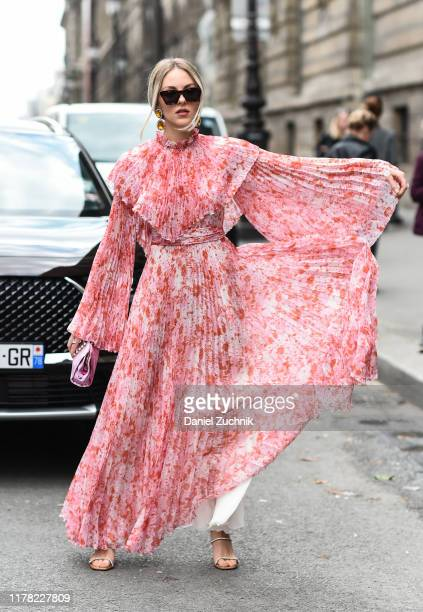 Shea Marie is seen wearing a pink and white floral Giambattista Valli dress outside the Giambattista Valli show during Paris Fashion Week SS20 on...