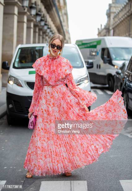 Shea Marie seen wearing salmon colored dress outside Giambattista Valli during Paris Fashion Week Womenswear Spring Summer 2020 on September 30, 2019...