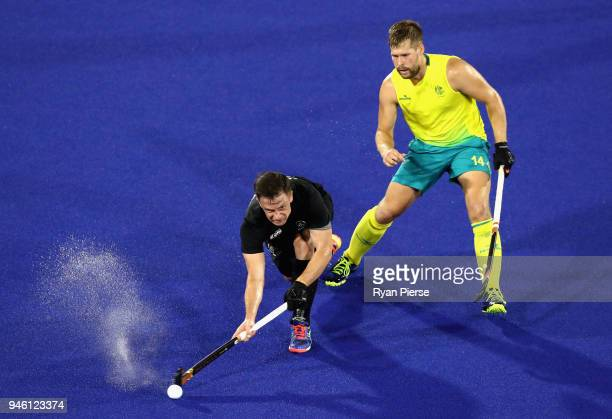 Shea Mcaleese of New Zealand holds off Aaron Kleinschmidt of Australia in the Men's gold medal match between Australia and New Zealand during Hockey...
