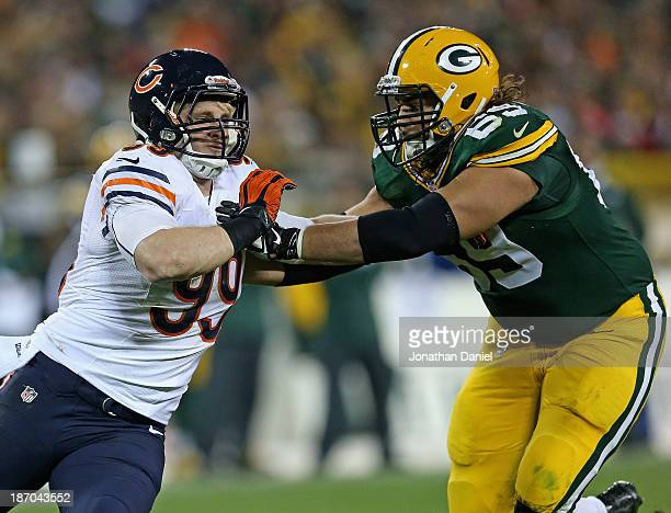 Shea McClellin of the Chicago Bears rushes against David Bakhtiari of the Green Bay Packers at Lambeau Field on November 4 2013 in Green Bay...