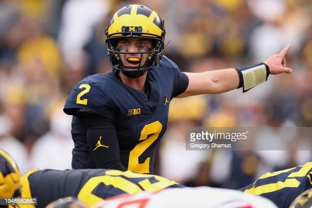 Shea Patterson of the Michigan Wolverines calls out to his teammates while playing the Maryland Terrapins on October 6 2018 at Michigan Stadium in...