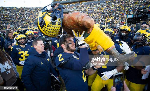 Shea Patterson of the Michigan Wolverines celebrates a win over the Michigan State Spartans at Michigan Stadium on November 16 2019 in Ann Arbor...