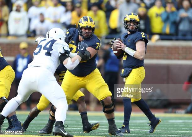 Shea Patterson of the Michigan Wolverines drops back to pass during the first quarter of the game against the Penn State Nittany Lions at Michigan...