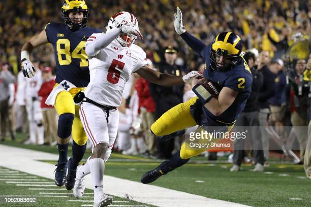 Shea Patterson of the Michigan Wolverines is knocked out of bounds after a long first half run by Rachad Wildgoose of the Wisconsin Badgers on...