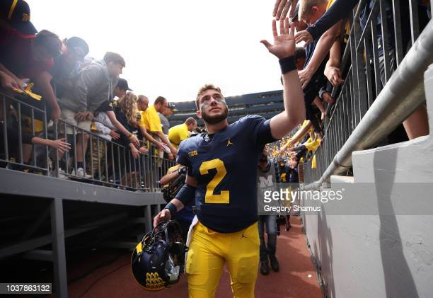 Shea Patterson of the Michigan Wolverines leaves the field after a 5610 win over the Nebraska Cornhuskers on September 22 2018 at Michigan Stadium in...