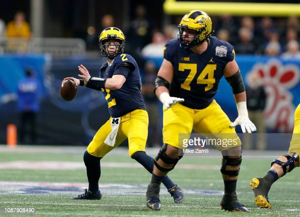 Shea Patterson of the Michigan Wolverines looks pass against the Florida Gators in the second quarter during the ChickfilA Peach Bowl at MercedesBenz...