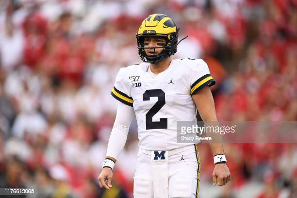 Shea Patterson of the Michigan Wolverines looks to pass during a game against the Wisconsin Badgers at Camp Randall Stadium on September 21 2019 in...