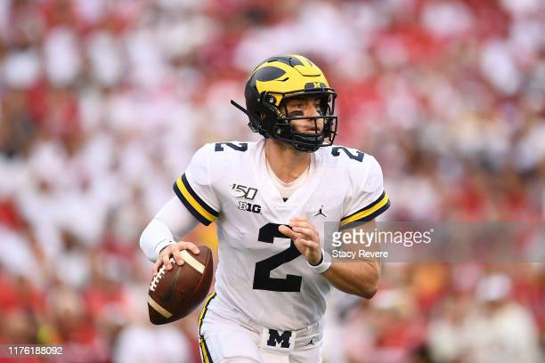 Shea Patterson of the Michigan Wolverines looks to pass during the first half against the Wisconsin Badgers at Camp Randall Stadium on September 21...