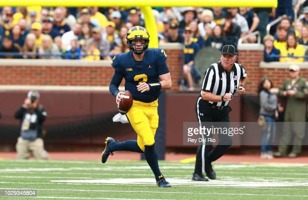Shea Patterson of the Michigan Wolverines looks to pass the ball in the second quarter against the Western Michigan Broncos at Michigan Stadium on...